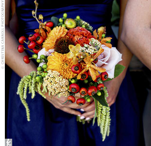 The girls carried smaller versions of Anna's bouquet with extra pops of red.