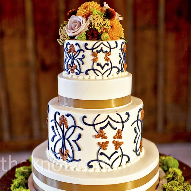 The cake design borrowed colors and patterns from the day's stationery and was topped with flowers to match Anna's bouquet.