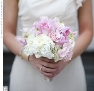 Soft flowers, such as peonies, hydrangeas and garden roses, in pink and white made up the petite bouquets the girls carried.