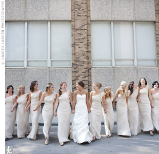 The bridesmaids wore one-shoulder champagne chiffon gowns for a formal and fun look. The junior bridesmaids wore light pink.