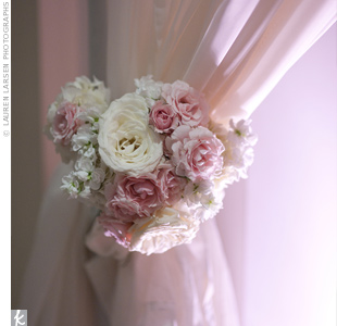 Blush-pink curtains fastened with small bunches of pink and white flowers hid the reception area from view during the cocktail hour.
