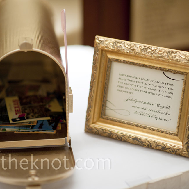 Guests signed postcards from places the couple had traveled together and left them in a gold mailbox.