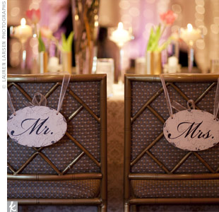 Slightly weathered signs marked Molly's and Chris's chairs at the reception for vintage touch.