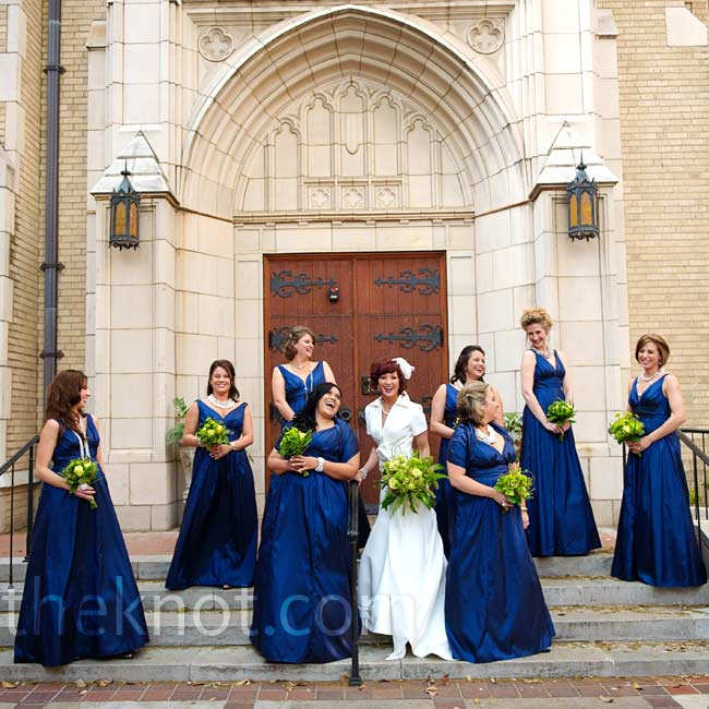Courtney's bridesmaids wore deep V-neck gowns with full skirts.