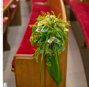 The first six pews at the church were decorated with bright bunches of greenery.