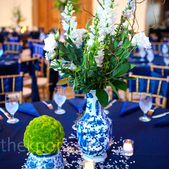 Antique blue-and-white Chinese vases and bowls filled with green and white flowers brightened up the navy linens. Lots of votives added a romantic glow.