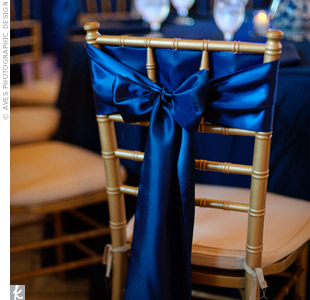 Navy chair sashes and table linens set a dramatic mood.
