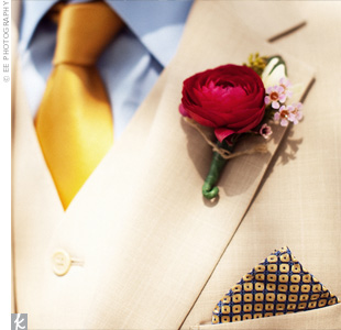 A single red ranunculus on Ira's lapel contrasted with his shiny yellow tie.