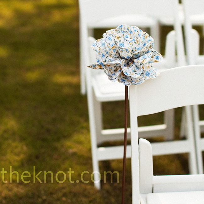"Kelley crafted big fabric flowers on long dowels, which were ""planted"" along both sides of the aisle."