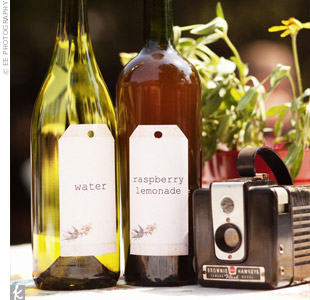 Leading up to the wedding, the couple saved empty wine bottles to use to serve drinks. Kelley's collection of vintage cameras added extra charm to the décor.