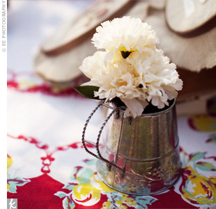 A mix of containers, like vintage tins, held loose flowers for a casual look.