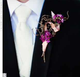 Sam wore a free-form boutonniere of purple wax flowers and grapevines.