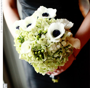Green hydrangeas and black-and-white anemones popped against the girls black dresses.