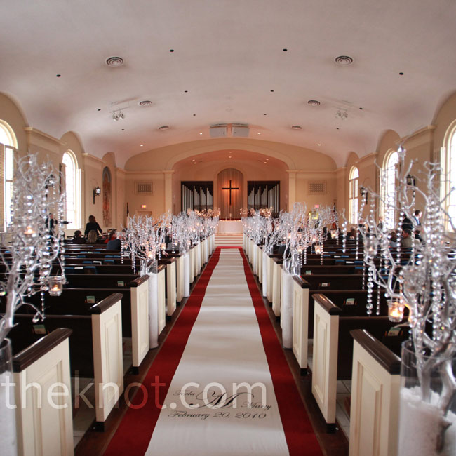 The couple went all-out with aisle décor: Silver trees draped with crystal strands stood in tall vases filled with faux snow.