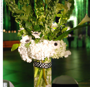 Green bells of Ireland and calla lilies stood tall in the centerpieces of hydrangeas, anemones and submerged orchids.