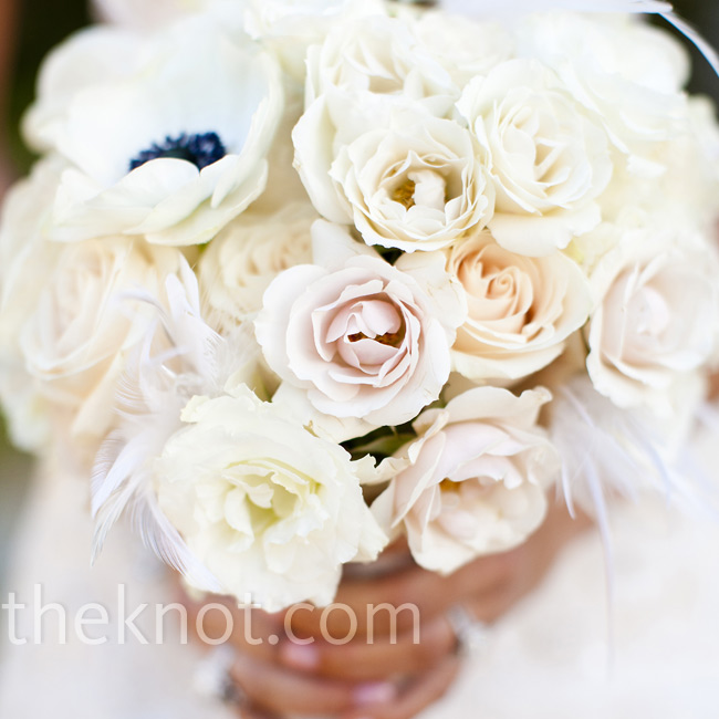 Taylor carried a delicate mix of flowers finished with feathers.