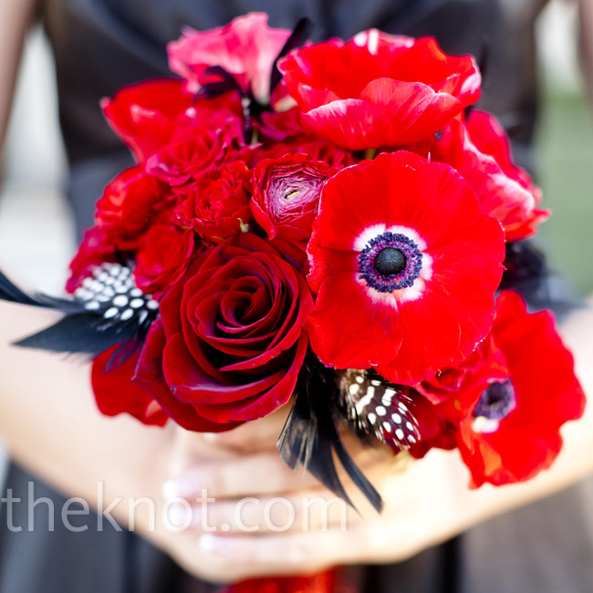 Feathers added personality to the all-red bouquets.
