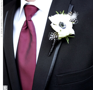 The black and white spotted feathers in Adam's boutonniere were an unexpected touch.