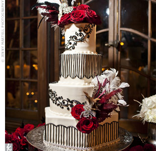 Red roses, brooches and intricate piping added lots of drama to the four-tiered cake.