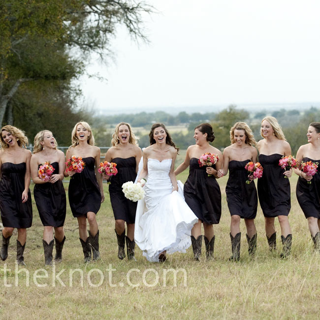The bridesmaids mirrored the day's style (elegant but relaxed) perfectly in strapless brown satin dresses and cowboy boots.