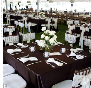 Simple lace bows tied to the dinner chairs helped achieve the elegant look Callie and Kris were after.