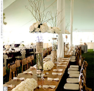 Tall cylinder vases topped with hydrangeas, roses and curly willow made the head table stand out.