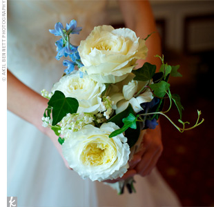 Shannon carried a loosely tied bouquet of cream garden roses, lilies of the valley, gardenias, magnolia leaves, ivy vines and a hint of blue delphiniums.
