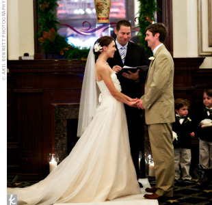 The ceremony took place in front of an oak fireplace highlighted by a mirror and a vase of hydrangeas.
