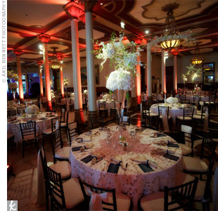 Soaring arrangements of hydrangeas, dendrobium orchids and white spray roses mirrored the ballroom's elegance.