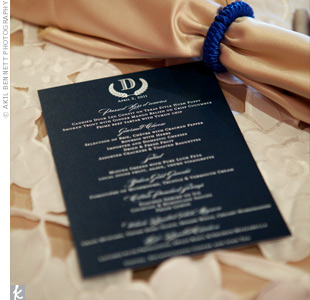 Elegant navy menu cards were decorated with the couple's monogram.