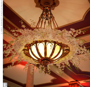 Garlands of hydrangeas and orchids dressed up the existing chandeliers.