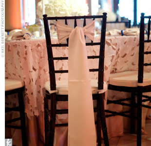 Lightweight fabric draped from the backs of the chairs complemented the delicate lace tablecloths.