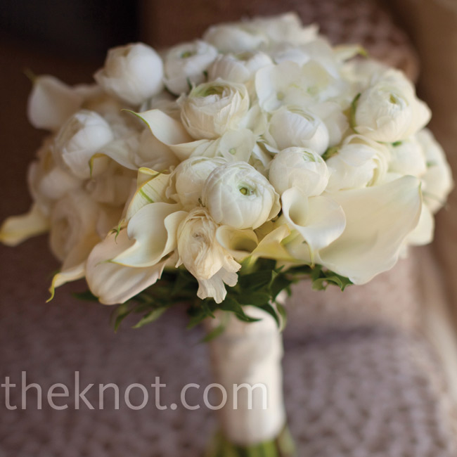 Julie held a round, all-white bouquet of ranunculus, hydrangeas and calla lilies for a classic look.