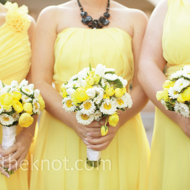 White asters with yellow centers, yellow tulips and ranunculus were a natural match for the girls' cheerful chiffon gowns.