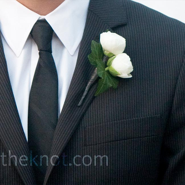 Trey's white ranunculus boutonniere stood out among the yellow ones his groomsmen wore.