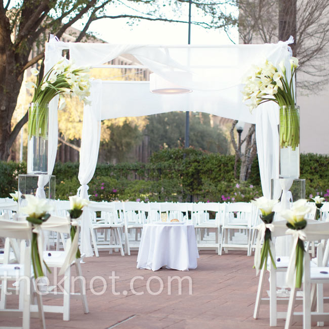Chairs were arranged in a circle surrounding the draped huppah that Julie's mom and brother made for the occasion.