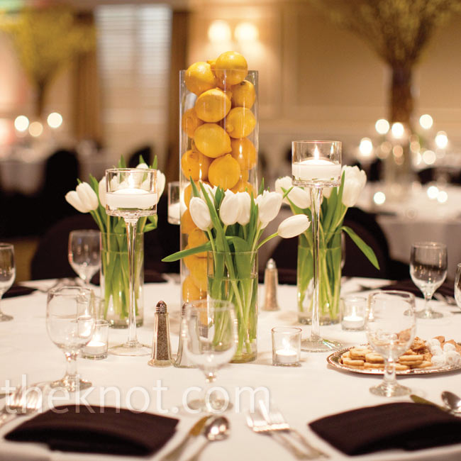 Some tables were topped with lemon-filled vases surrounded by trios of white tulip arrangements for a sleek, elegant look.