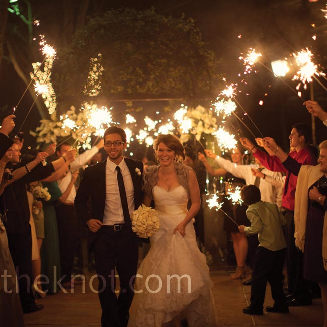Guests waved sparklers as Julie and Trey made their way to the getaway car.