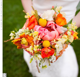 Janna's elegant, loose arrangement of pink, coral, orange and yellow blooms was accented with pink hypericum berries and greenery.