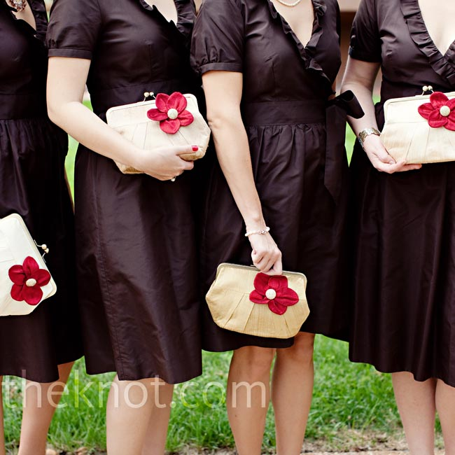 Brit chose silk taffeta wrap dresses in chocolate brown for her girls. Instead of bouquets, they carried complementary clutches.