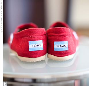 Following the ceremony, Brit traded her pumps for a dance floor-friendly pair of red TOMS.