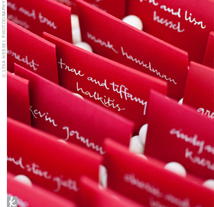 The escort cards were placed inside small red envelopes and propped up in trays of white gumballs.