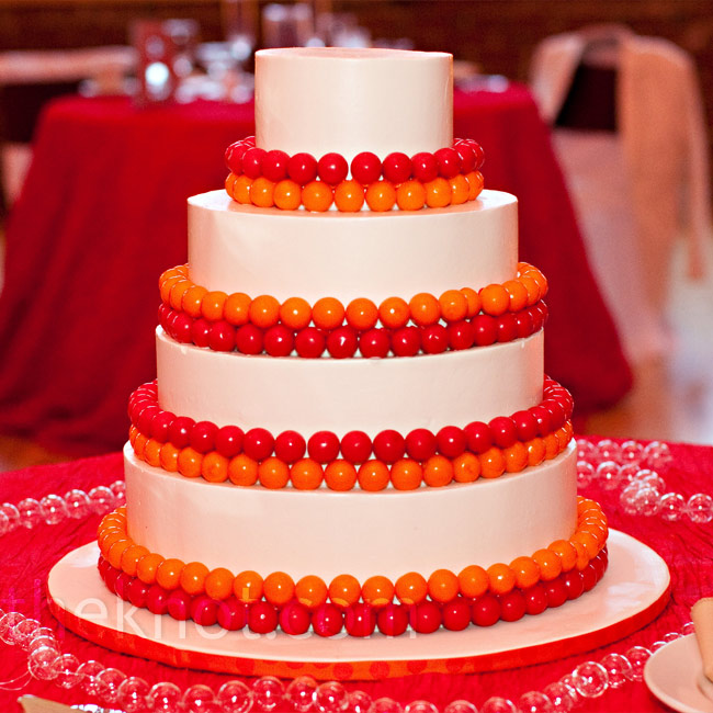 Each layer of the white buttercream cake was lined with red and orange gumballs to tie into the circle theme.