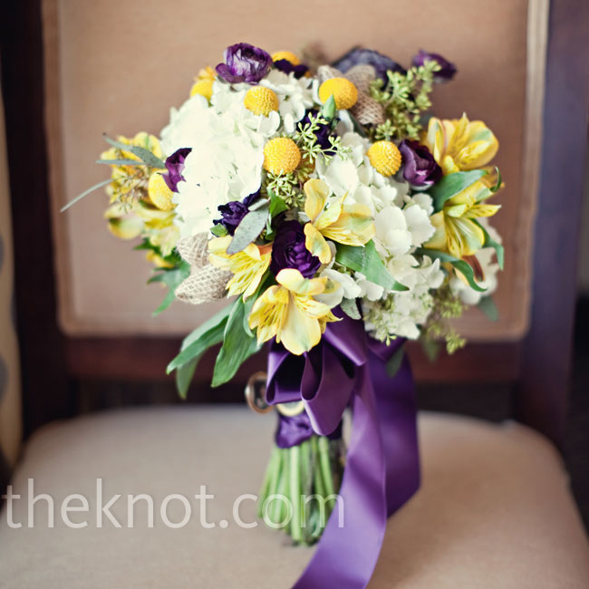 Jacqui's gorgeous bouquet was filled with white hydrangeas, purple ranunculus, yellow alstroemeria and craspedia plus burlap flowers for added texture.