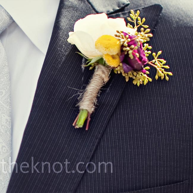 White roses paired with yellow feverfew and seeded eucalyptus were wrapped in twine to form the boutonniere.