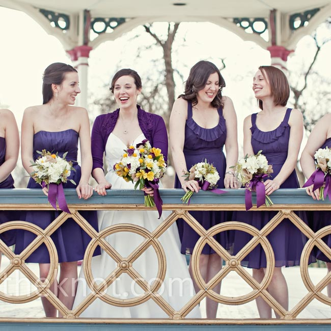 Mismatched dresses in a rich purple hue were the perfect way for the bridesmaids to show off their own personal style.