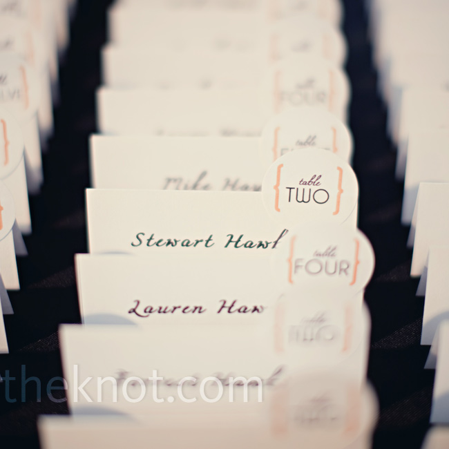 Simple tented escort cards had a small circle with the table number popping up from the edge of the card.