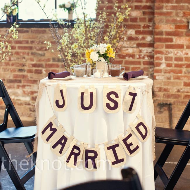 Jacqui and Mark enjoyed some privacy at their sweetheart table decorated with a burlap banner.