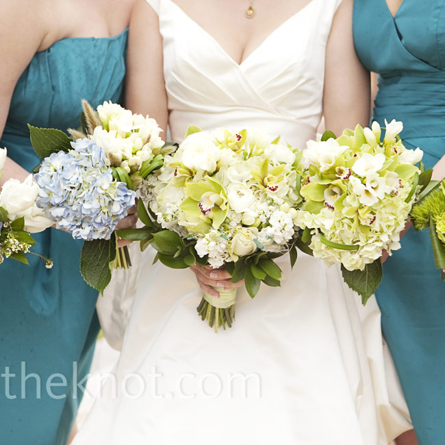 Julie's bouquet of hydrangeas, orchids and roses featured green wire with beading threaded through the flowers. Her bridesmaids each carried a unique bouquet of blooms.