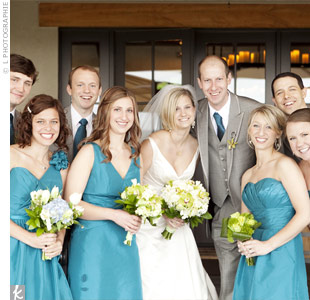 Teal dresses in different styles were the perfect fit for Julie's bridesmaids. The groomsmen wore gray tuxes with matching teal ties.